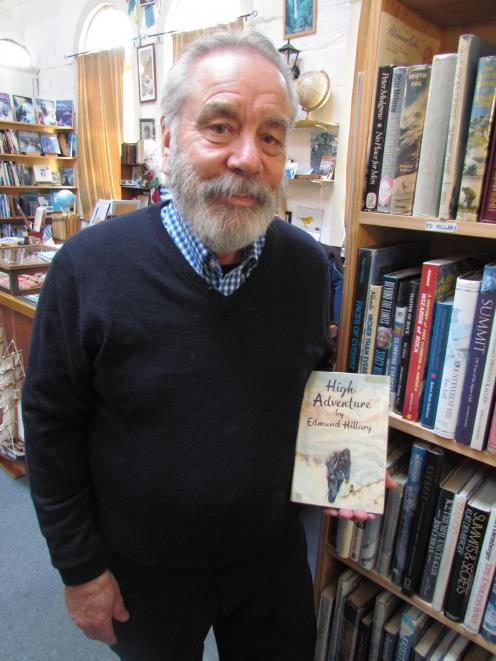 Adventure Books owner Bill Nye holds a first edition of Sir Edmund Hillary's first book on the...