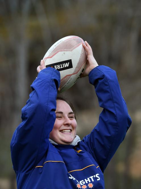 Otago Spirit captain and hooker Tegan Hollows throws the ball into a lineout at practice on...