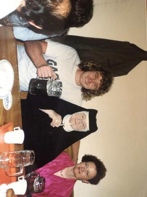Mr Mould's favourite photo of himself with a nun and her niece at Oktoberfest. PHOTO: SUPPLIED