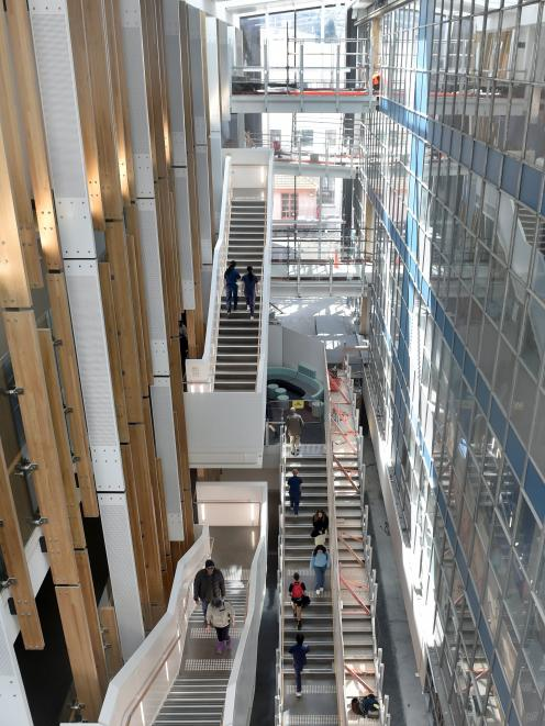 Pedestrians climb stairs in the recently revealed atrium at the University of Otago School of...