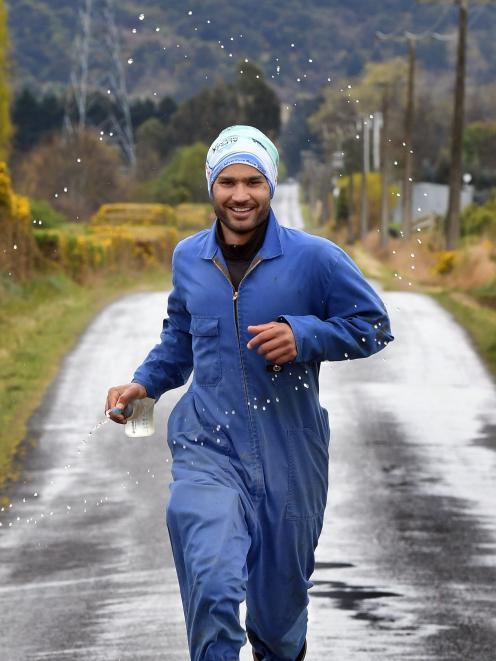 Woodside dairy farmer Harrie Chander is training to run the Queenstown Marathon in his work...