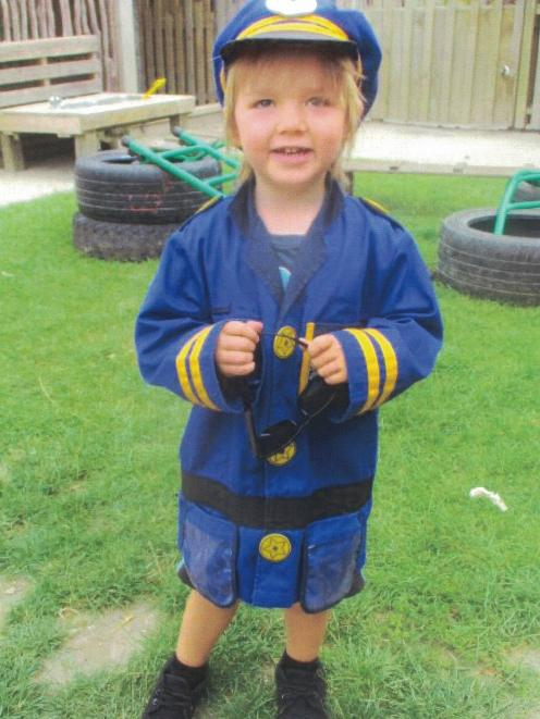 Gore toddler Lachlan Jones loved pretending to be a policeman, his father says. Photo: Jones family