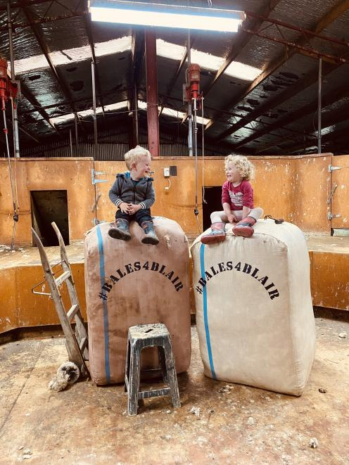 Cousins Jacob McRae and Tessa Cameron (both 2), of Mokoreta, sit on the top of wool bales. The...