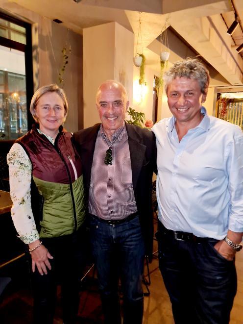 Waiata winemaker Evan Ward (centre) with Sue and Royce Mckean