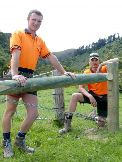 Hughes Johnston Fencing owner Isaac Johnston (left) and employee Aidan Brown put in some practice...