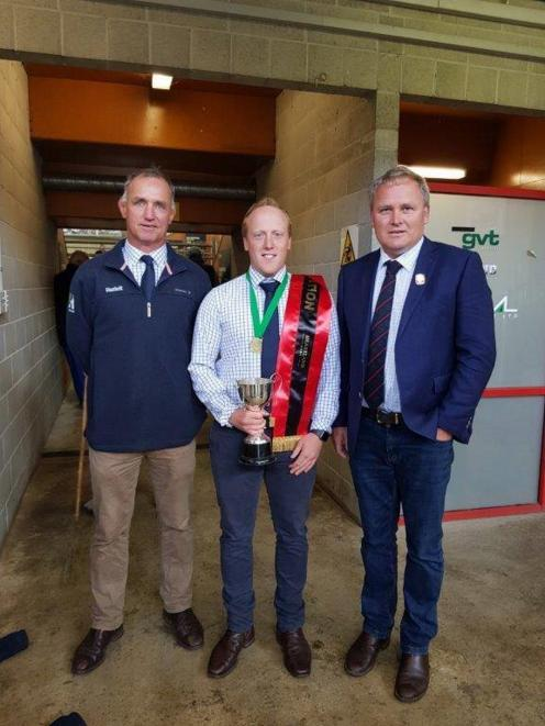 Andrew Sherratt (centre) is congratulated by Jim Hazlett (left) and Canterbury A&P Association co...