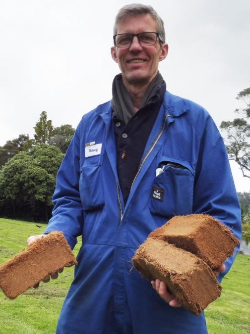 Rhododendron Dell curator Doug Thomson is using coco peat, made from coir, instead of peat. PHOTO...