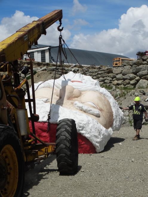 The Santa is unloaded at the Wanaka National Transport and Toy Museum. Photo: Mark Price