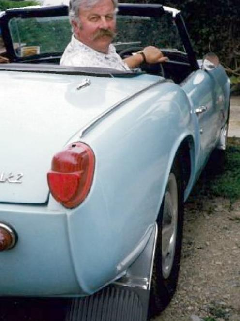 Rice in his 1965 Triumph Spitfire Mark 2, in the early 2000s.