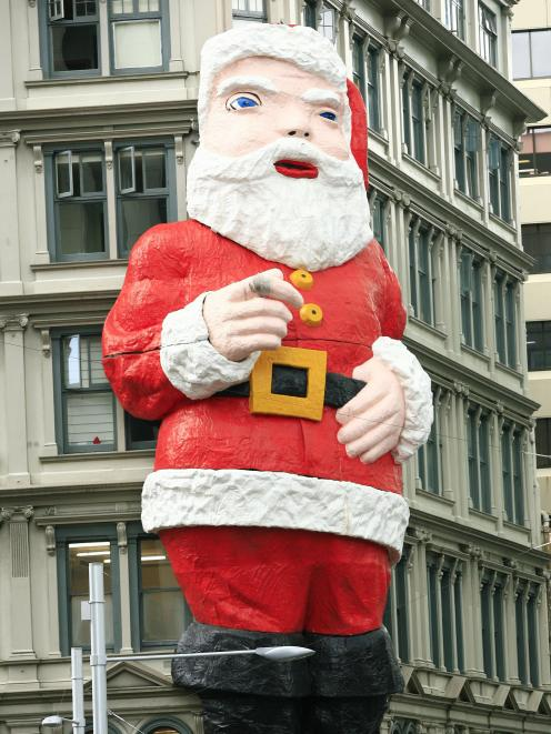 The giant Santa seen on the Whitcoulls building, in central Auckland....
