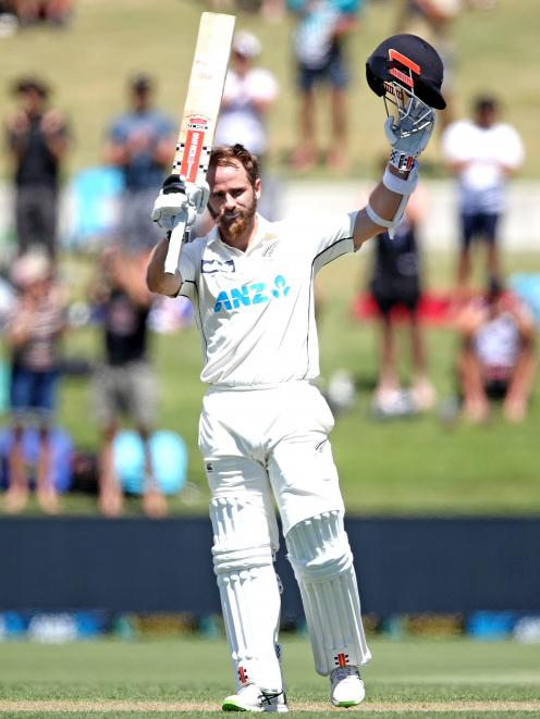 Kane Williamson makes his century during day two of the first test match in the series between...