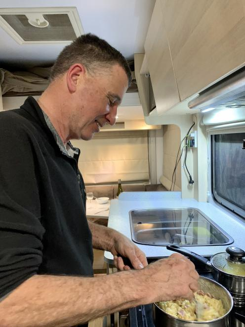 ''Captain'' Chris cooks dinner in our cosy Maui Cascade motorhome.