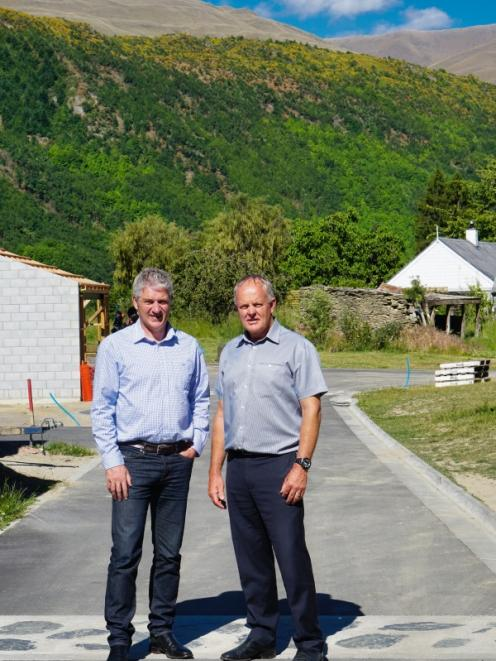 Colliers co-listing brokers Rory O'Donnell, left, and Fred Bramwell on the site of the history-infused Three Mayors Ridge subdivision. Photo: Mountain Scene