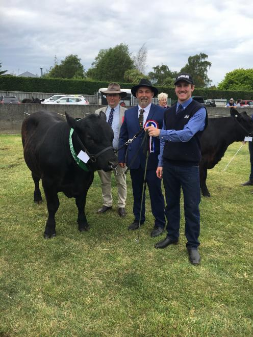 Cattle judge Warrick James (left) and Courtenay A&P Show president Richard Westaway (centre)...