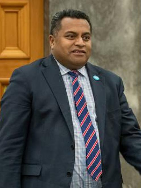 Immigration Minister Kris Faafoi on his way into the House for Question Time, Parliament. Photo:...