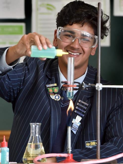 King's High School year 12 pupil Narayan Shastri polishes his chemistry skills in preparation for...