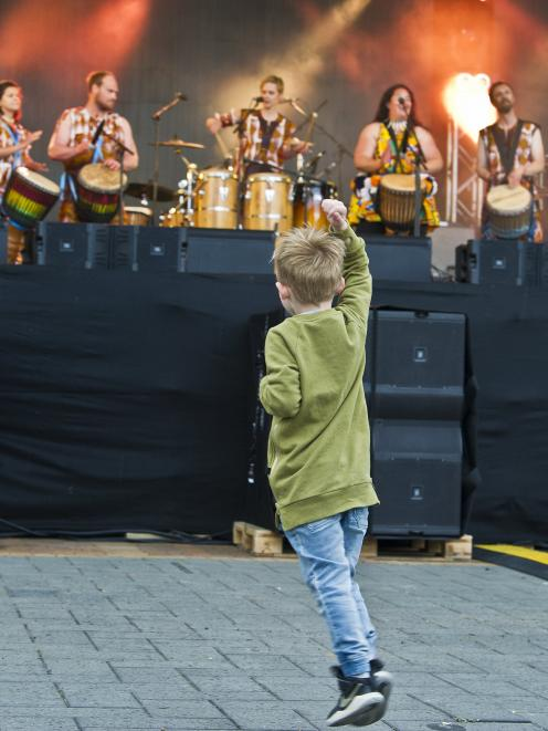 Fletcher Moore (4)  dances along with Kadodo West African Drum and Dance group in the Octagon....