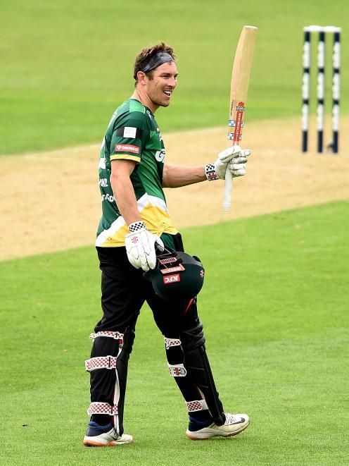 Stag batsman George Worker celebrates brining up his century.