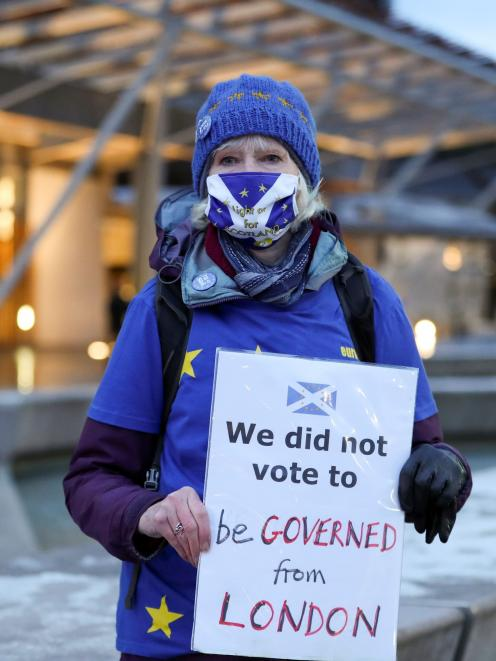 An anti-Brexit protester holds a sign outside the Scottish Parliament in Edinburgh. PHOTO: REUTERS