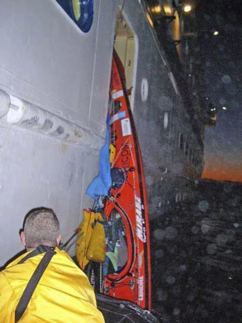 Crew members of the cruise ship Clipper recover a kayak from the Tasman Sea off Milford Sound....