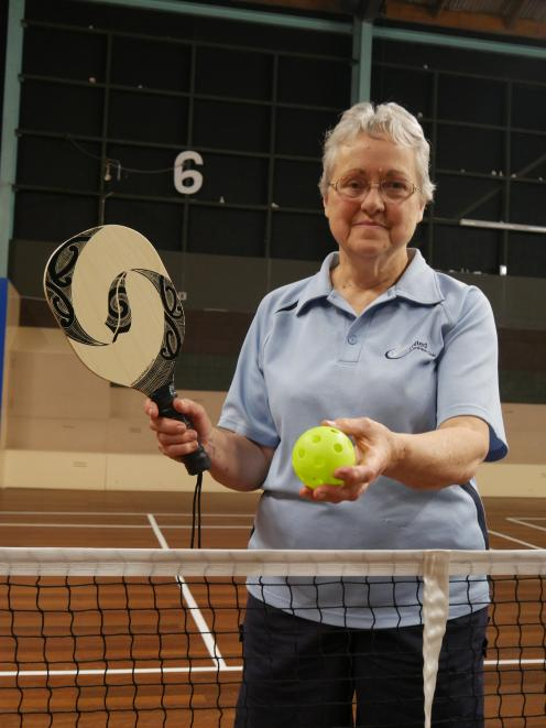 Otago Badminton Association secretary Shirley Woodrow holds the bat and plastic ball used in...
