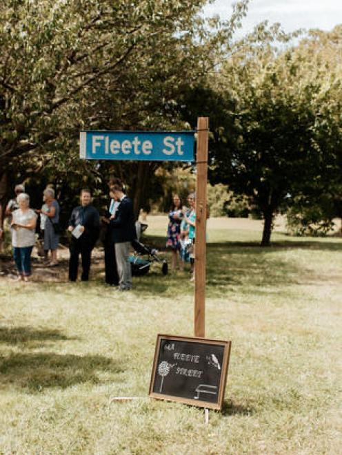 A fake Fleete St sign welcomed Katie Hantley's wedding guests to the site of her former family...