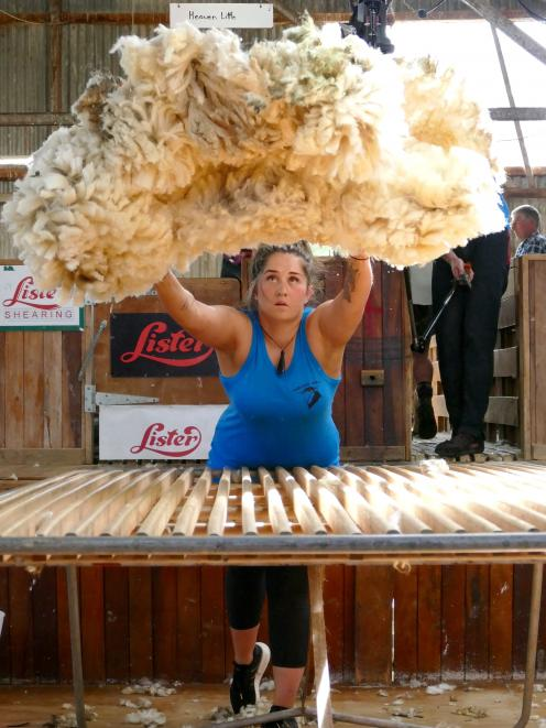 Heaven Little, of Balclutha, casts her fleece during the heats of the Otago Woolhandling Senior...