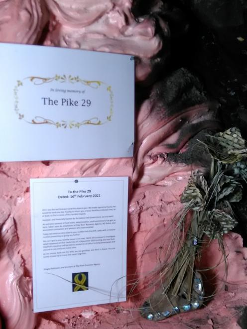 Families of the Pike 29 gave the agency mementoes which were placed into the Rocsil plug facing...