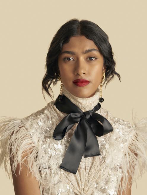 A model wearing Anna Ross' Kester Black lipstick.