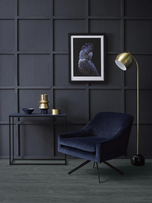 An inky blue batten wall in Resene Indian Ink makes for an elegant backdrop for a rich and...