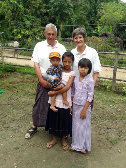 Ken and Margaret Tustin pictured with local children in Myanmar in 2013. PHOTOS: SUPPLIED