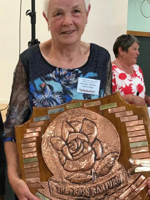 North Otago Rose Society president Christine Schaffer holds the South Island Rose Ranfurly Shield...