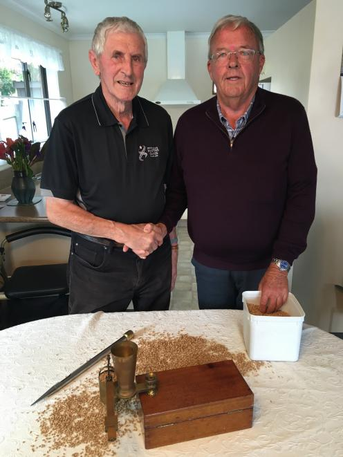 Temuka and Geraldine A&P Show grain judge Lindsay ''Slim'' Green (left) hands over to new judge...