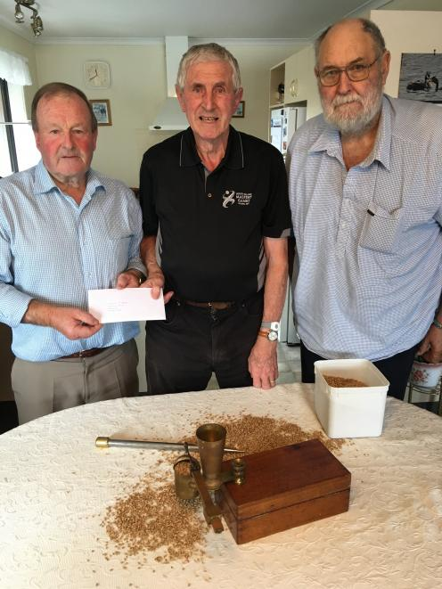 Temuka and Geraldine A&P Show grain convener Warren Stratford (left) hands over a thank-you gift...
