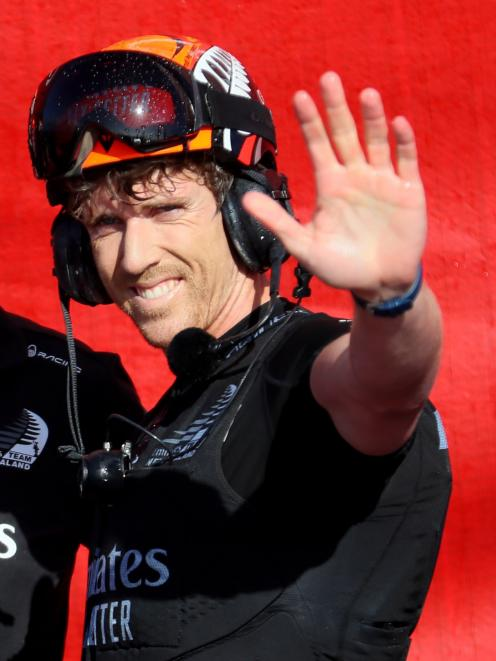 A delighted Team NZ helmsman Peter Burling acknowledges the crowd in Auckland. Photo: Reuters