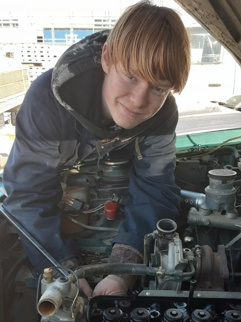Mac Emeny (15) works under the bonnet of a vehicle at Camco Autos as part of the Central Otago...