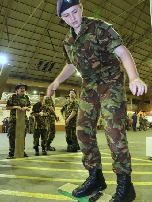 City of Dunedin Cadet Unit cadet Flynn McCormick (14), a pupil  at King's High School, keeps his...