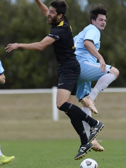 New colours . . . Ryan Fleming sports the new South City Royals blue strip as he contest the ball...