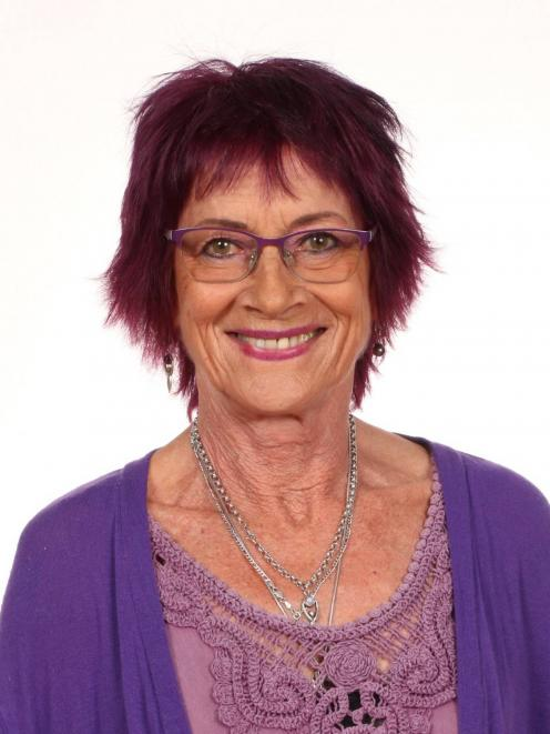 Purple-loving Westmere School teacher Julie Ann Hamilton, 67, was remembered by hundreds on...