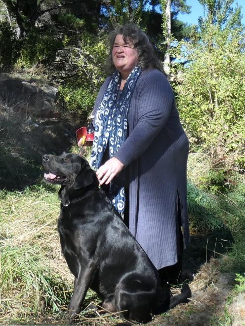 Judy Cockeram and her dog Maestro survey the scene of the crime. PHOTO: SIMON HENDERSON