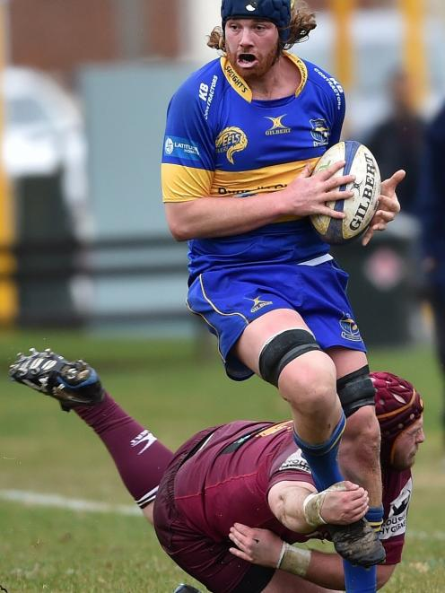 Taieri lock Brodie Hume is grabbed by Alhambra-Union front rower Alex Frood at the North Ground...