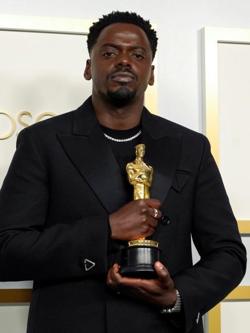 Daniel Kaluuya with his Oscar. Photo: Reuters