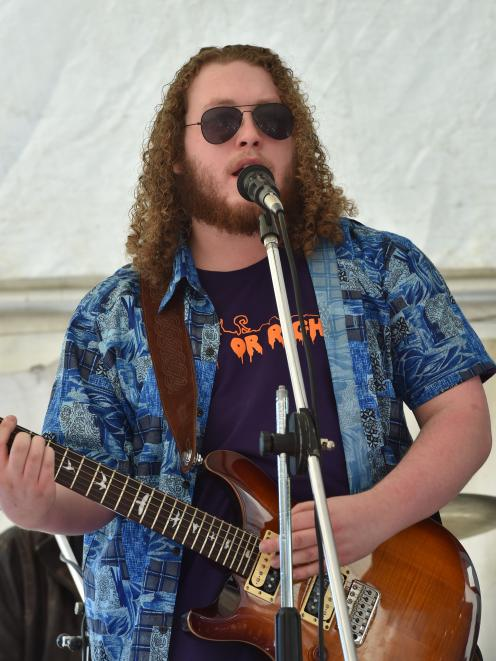 Saurian guitarist and vocalist Karl Brinsdon performs in a tent outside the library.