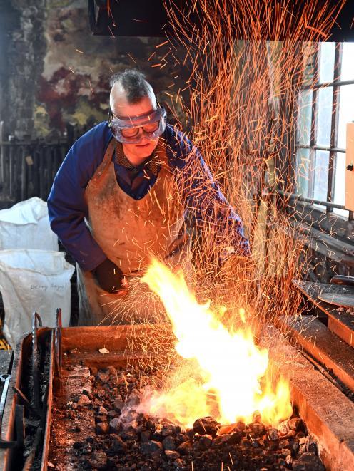 Dunedin builder and blacksmith Peter Mason operates a forge at the Dunedin Gasworks on Saturday,...