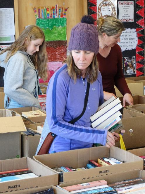 Browsing for books at the St Joseph's School Book Fair in Queenstown yesterday is Katrina Preston...