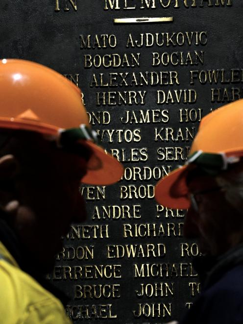 Guests honour the 16 men they worked with during construction of the station who lost their lives.