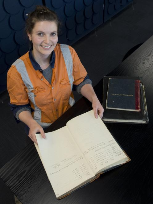 Archaeologist Megan Lawrence with a company record of Hudson & Co, discovered stashed away in the...