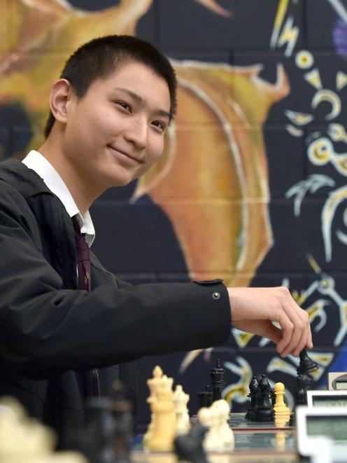 Logan Park High School pupil Alexander Sun makes a move.