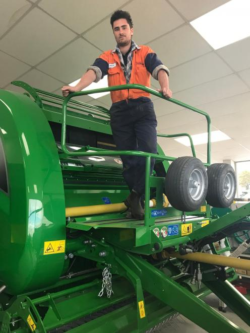 Power Farming Timaru Apprentice of the Year Gemyn Bell enjoys working with farm machinery. PHOTO:...