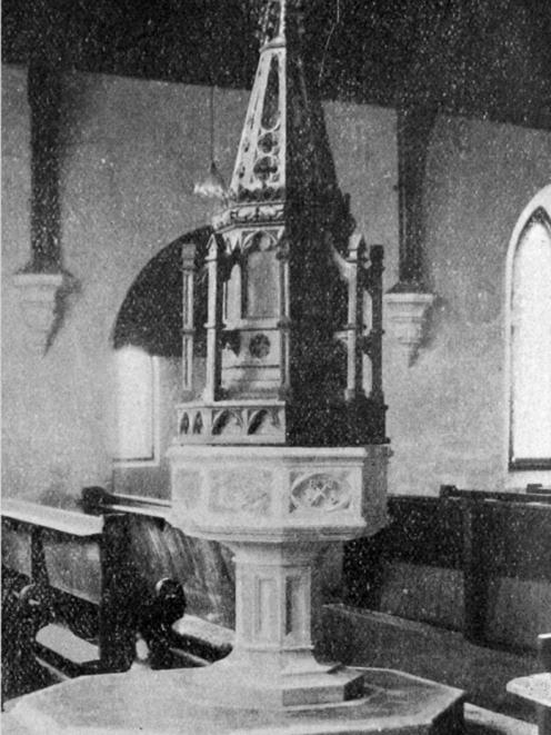 The memorial font canopy at St Peter's Church, Caversham, constructed of oak and representing a...